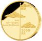 Fotografi av ett 2000-kronors minnesmynt i guld, frånsida, 100-årsminnet av unionsupplösningen mellan Sverige och Norge